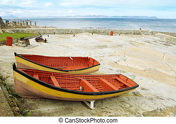 harbour 1 - Two red and yeallow derelict boats on Hermanus...