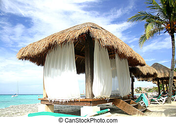 Beach Hut - Thatched hut on the beach in Cancun, Mexico
