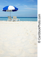 Umbrella on Beach - Umbrella on white sand beach