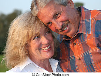 Flirting Couple - a good-looking mature couple flirting with...