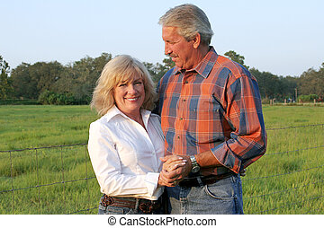 Handsome Farm Couple - a good-looking, mature couple on a...