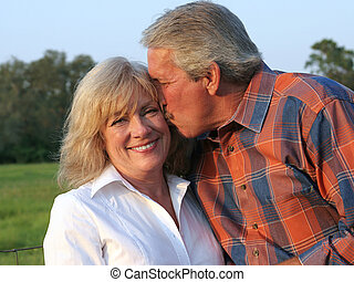 Loving Husband - an attractive man giving his beautiful wife...