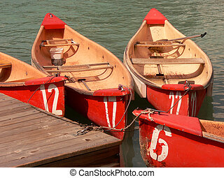 Numbered Canoes - Rental canoes at Lake Louise, Banff...