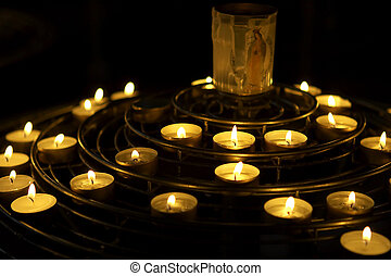 prayer candles - Candles lit as a prayer, Notre dame,...