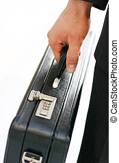 business briefcase - Business man holding his briefcase