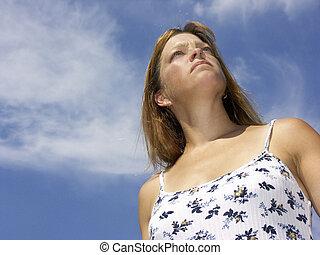 peaceful - woman against sky