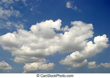 Clouds - White fluffy clouds cumulus nimbus against a blue...