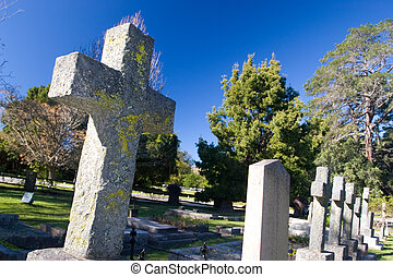 graves #11 - Old stone Grave in the shape of a cross at the...