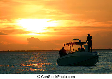 Sunset Speedboat - Speed boat with sunset behind