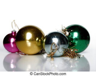 Christmas ornaments - Four Christmas ornaments over white