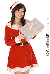 Miss Santa and Present - A cute asian girl in a santa...