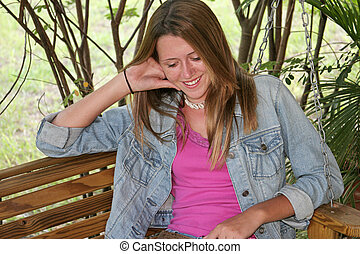Beautiful Girl Laughing - A beautiful teen girl on a porch...
