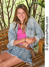 Girl On Porch Swing 1 - A beautiful teen girl on a porch...