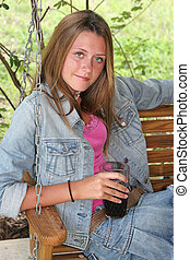 Girl With Cold Drink - A beautiful teen girl drinking a cold...