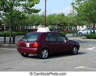 Learner driver practicing in parking lot