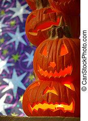 Jack O Lanterns - Halloween decoration - a stack of pumpkins...