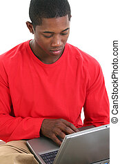 Casual Man Laptop - Casual man in red shirt working on...