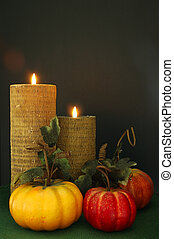 Thanksgiving Decor - Lighted candles and decorative gourds...
