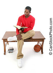 Man Book Reading - Casual Man Sitting on Table Reading Book...