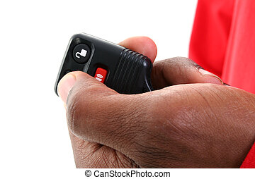 Keyless Entry Car - Man's hand on a keyless entry against...