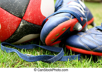 Rugby ball with boots on grass