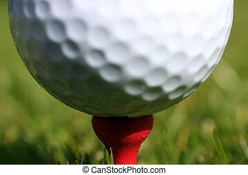 Golfball on tee. Focus is on tee.