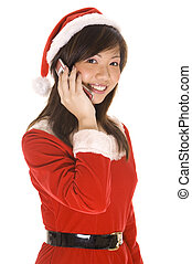 Santarina On The Phone - A cute asian woman in a santa...
