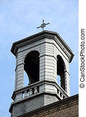 church spire - A church spire against a blue sky