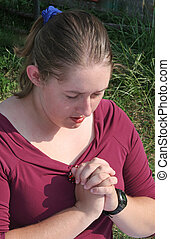 Deep In Prayer 1 - An attractive girl deep in prayer.