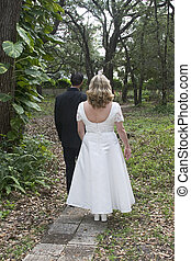 Path To The Future - A newlywed couple headed down a wooded...