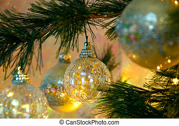 Christmas Tree - The miniature golden lights of the...
