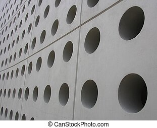 Perforated - Holes in a wall of a modern building
