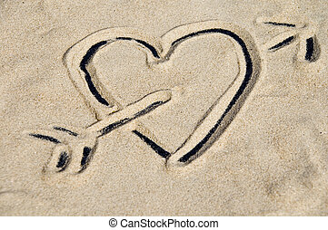 Heart with arrow - Symbol for in love with depicted in sand...