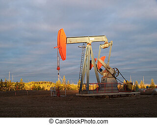 Pumpjack in morning - Pumpjack and far side o fa velley lit...