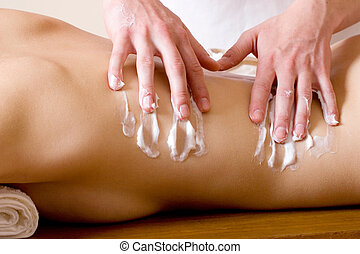 massage 20 - Woman lying on massage table with the hands of...