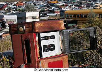old gas pump, abandoned at a junkyard