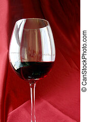 Wine Glass - Wine glass against red drape