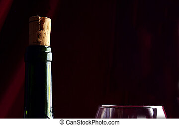 Wine Still Life - Wine bottle with cork and glass against...