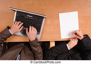 document preparation - 2 men working over the project with...
