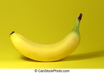 Banana on yellow background