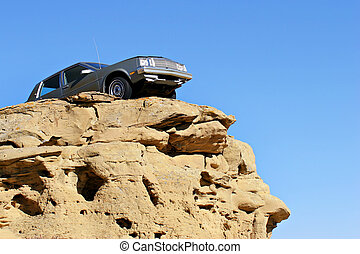 on the edge - car dangerously close to the edge of a...