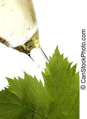 White Wine - White wine and vine leaf on white