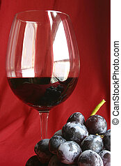 Glass and Grapes - Red wine in glass with bunch of grapes