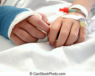 Child In Hospital - A child's hands, one in a cast the other...