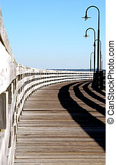old pier - old wooden pier with old lamposts in the late...