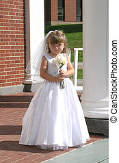 flower girl in white dress and wedding veil