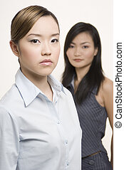 Businesswomen 2 - Two serious-looking but attractive asian...