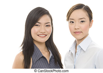Businesswomen 5 - Two attractive asian businesswomen - both...