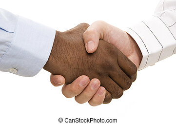 Handshake - A close-up of two hands different races shaking...