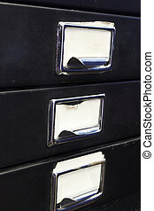 Filing cabinet #3 - Close-up of a black mini filing cabinet...